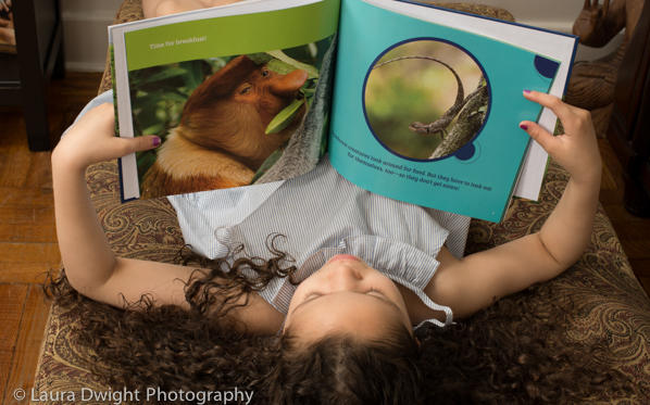 6 year old reading All in a Rainforest Day