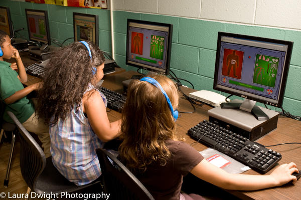 First grade students using computers in science class