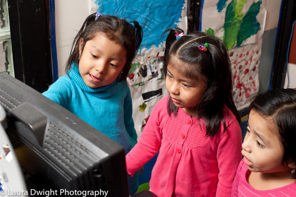 5 year old girls using computer to play educational game