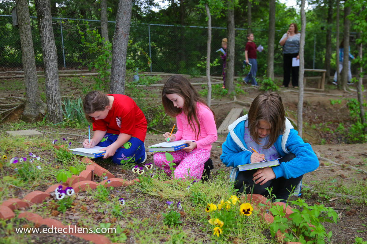 Citizen Science in K-5 Classroom Elementary school students writing observations plants