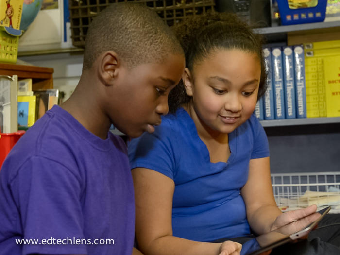 Two students using an iPad