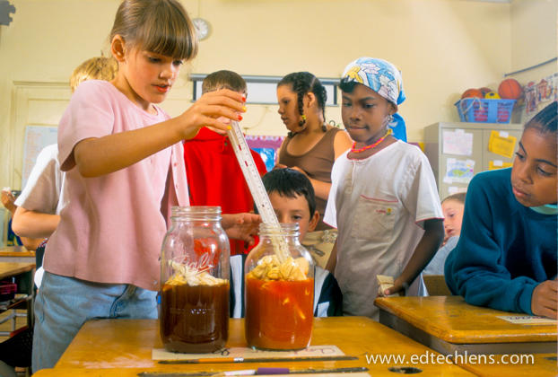 Second grade students experimented with making dyes of different colors from nature. After making charts of their results, they chose dyes made from beets and turmeric to make tie-dyed shirts.
