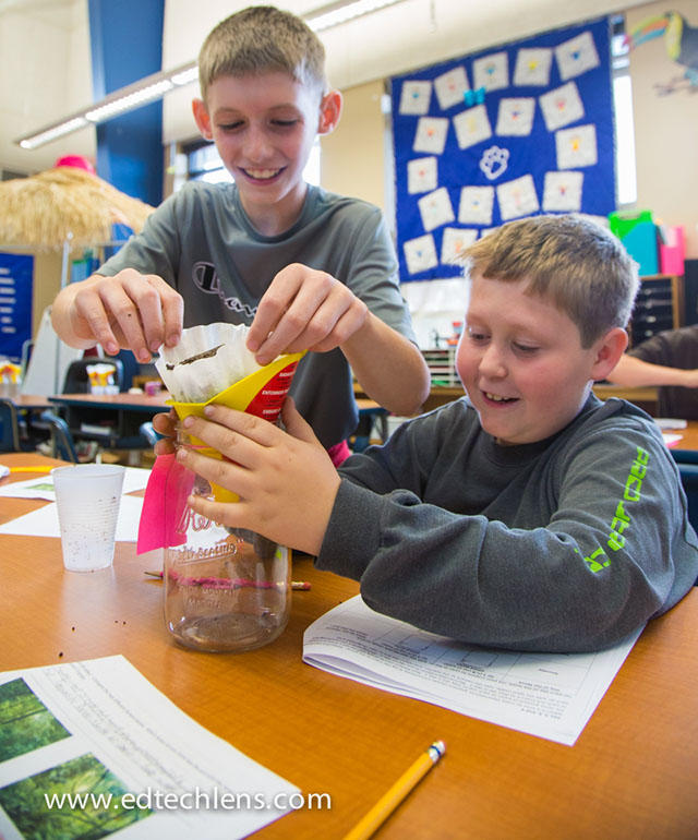 Elementary students working on science activity