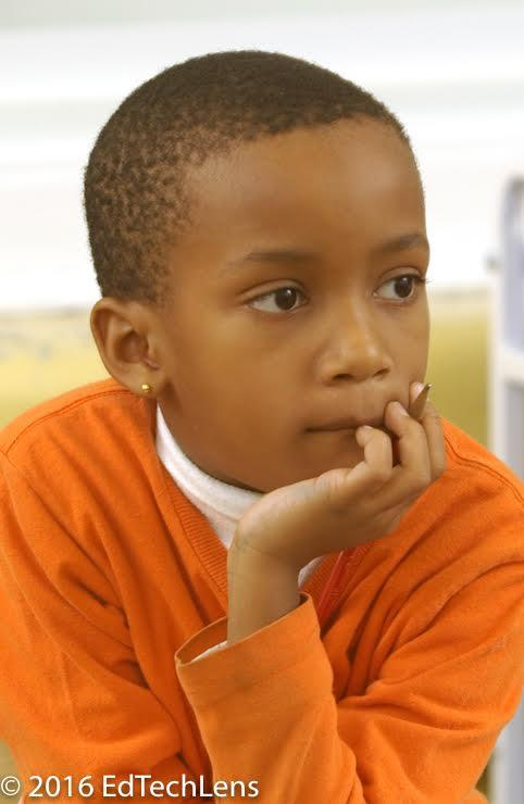 Second-grade boy listening and thinking in class.